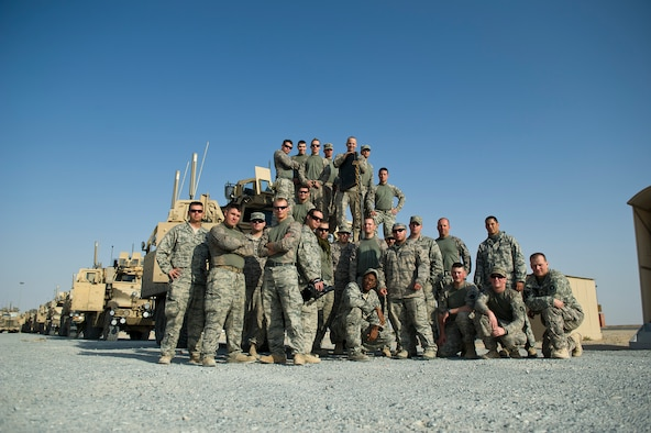 U.S. Air Force members assigned to the 70th medium truck detachment and U.S. Army Minnesota National Guard members assigned to B-Troop, 1-94 Cavalry, Pine City MN, pose for a group photo after successfully transporting equipment out of Iraq on Oct. 30, 2011. The Joint team drove more than 1,100 miles and hauled 43 truckloads of supplies and equipment out of Iraq. The 70th MTD runs the convoy operations while B-Troop provides security. (U.S. Air Force Photo/Master Sgt. Jeffrey Allen)