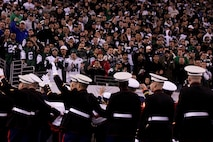EAST RUTHERFORD, N.J. -- Marines wave back to a cheering crowd after a pregame ceremony before the  the New York Jets vs New England Patriots game, Nov. 13. The West Point Band performed at half time and 100 service members presented the large flag during the National Anthem. (Official Marine Corps photo by Sgt. Randall A. Clinton / RELEASED)
