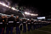 EAST RUTHERFORD, N.J. -- Marines, Sailors, Coast Guardsmen, Airmen and Soldiers unfurled an American Flag across the field during a pre-game ceremony before the New York Jets vs New England Patriots game, Nov. 13. The West Point Band performed at half time and 100 service members presented the large flag during the National Anthem. (Official Marine Corps photo by Sgt. Randall A. Clinton / RELEASED)