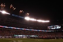 EAST RUTHERFORD, N.J. -- Marines wave back to a cheering crowd after a pregame ceremony before the  the New York Jets vs New England Patriots game, Nov. 13. The West Point Band performed at half time and 100 service members presented the large flag during the National Anthem. (Official Marine Corps photo by Cpl. Caleb Gomez / RELEASED)