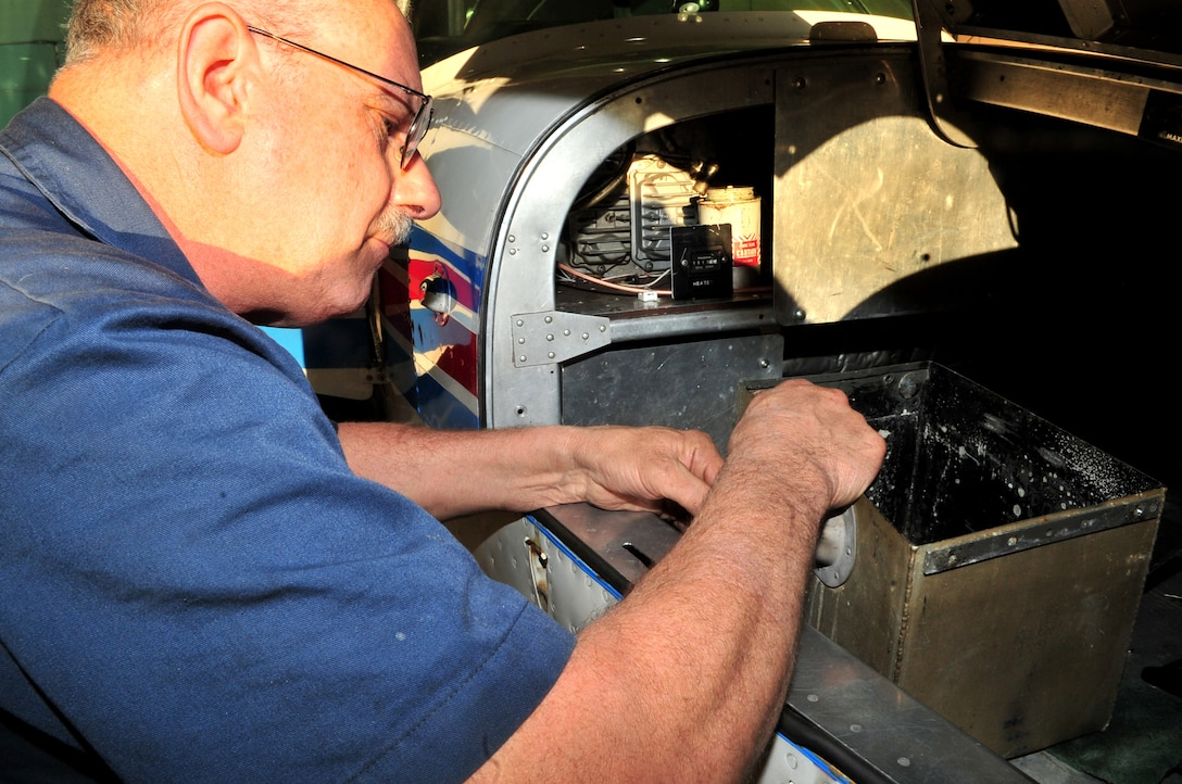 Chief mechanic Dean Williams of the Offutt Aero Club does repairs on a plane at the Offutt Aero Club. Mr. Williams is the only full time mechanic employed at the aero club.  (U.S. Air Force Photos by D.P. Heard)