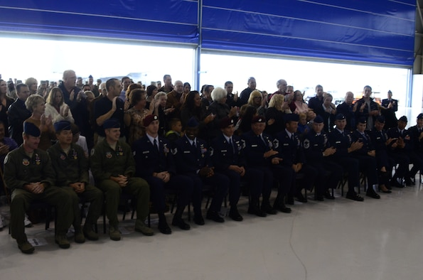 California Air National Guardsmen assigned with the 129th Rescue Wing are given a standing ovation after receiving the Distinguished Flying Cross with Valor for rescue missions in support of Operation Enduring Freedom inside Hangar 4, Moffett Federal Airfield, Calif., Nov. 5, 2011.  (Air National Guard photo by A1C John Pharr)
