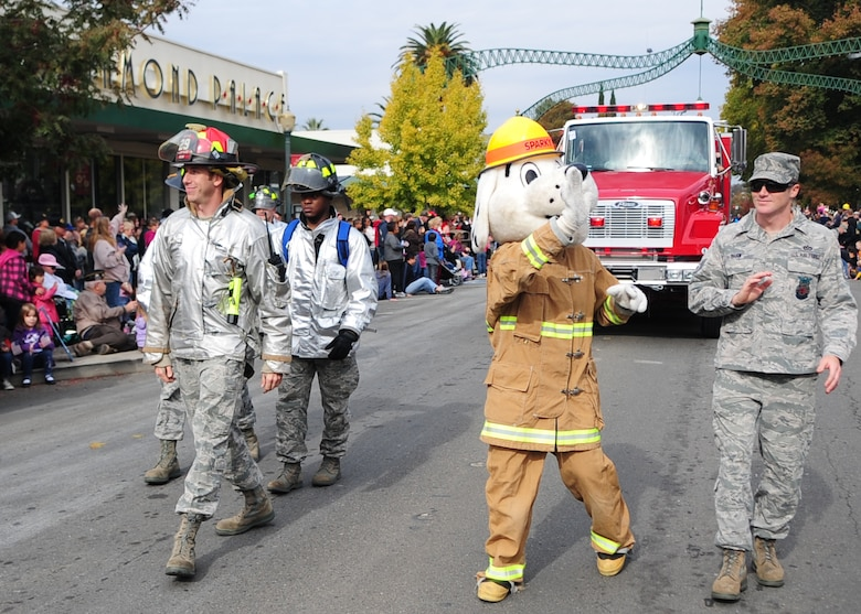 Sparky the Fire Dog waves to local community members attending the Veterans Day Parade in Marysville, Calif., November 11, 2011, while walking with Beale's 9th Civil Engineer Squadron (9th CES) Fire Department. The 9th CES showcased fire trucks, explosive ordinance disposal equipment and personal protective equipment throughout the parade route. (U.S. Air Force photo by Airman 1st Class Shawn Nickel)
