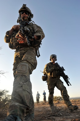 Senior Airman Eric Humphrey (left) and Staff Sgt. Andrew Rios, both 82nd Expeditionary Rescue Squadron pararescuemen, arrive on scene to attend to simulated casualties at a mock crash site during a training mission in the Grand Bara Desert, Djibouti, Oct. 21, 2011. After parachuting into the drop zone, Rios' team had to locate casualties, provide care and evacuate them to safety as a part of the scenario. (U.S. Air Force photo/Staff Sgt. Renae Saylock)