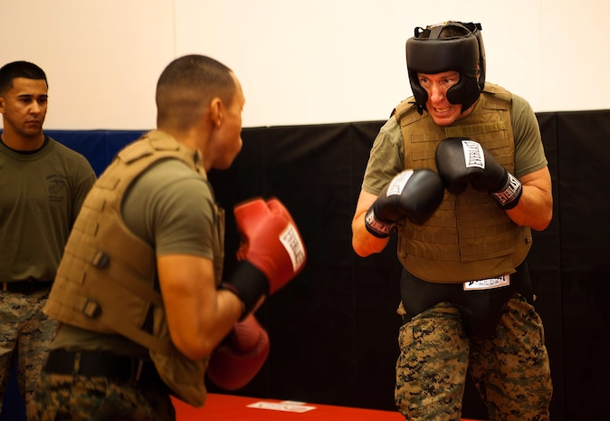 Lt. Col. Chris A. Feyedelem (right), head of the plans and operations branch, logistics section, U.S. Marine Corps Forces, Pacific, spars with Sgt. Corey Etibek, a Marine Corps Martial Arts Program instructor who works at Pacific Command, at the MCMAP room here Nov. 16. Sparring is a part of physical training in the current MCMAP course taught here Nov. 14-23.