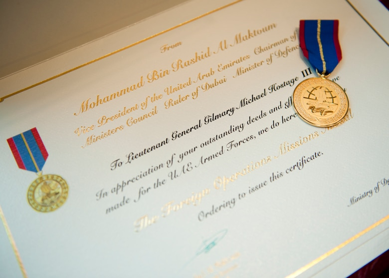 The Foreign Operations Medal and accompanying certificate that were presented to Air Combat Command commander, U.S. Air Force Gen. Mike Hostage III at the UAE Embassy, Washington D.C. on Nov. 15, 2011. (U.S. Air Force photo by Jim Varhegyi/Released)