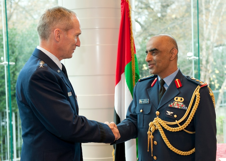 U.S. Air Force Gen. Mike Hostage III, is congratulated by the United Arab Emirates (UAE) Air Attaché Col. Abdelrahmn Al-Mazmiby after presenting the Foreign Operations Missions Medal to the general during a ceremony at the UAE Embassy, Washington D.C. on Nov. 15, 2011. (U.S. Air Force photo by Jim Varhegyi/Released)