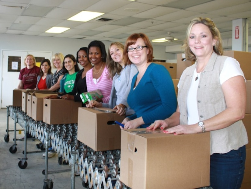 Joint Base Charleston- Air Base Team Charleston Spouses Club donated 56 pounds of food and $500 to the Lowcountry Food Bank.  The canned goods were used to help feed 41 families.