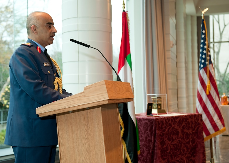 The United Emirates (UAE) Air Attaché Col. Abdelrahmn Al-Mazmiby gives opening remarks before presenting the Foreign Operations Missions Medal to Air Combat Command commander U.S. Air Force Gen. Mike Hostage III during a ceremony at the UAE Embassy, Washington D.C. on Nov. 15, 2011. (U.S. Air Force photo by Jim Varhegyi/Released)