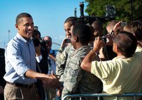 President Barack Obama greets Airmen and their families as he prepares to depart Joint Base Pearl Harbor-Hickam, Hawaii, following the Asia-Pacific Economic Cooperation conference in Honolulu on Nov. 15, 2011. The Airmen who met President Obama were selected by base leaders based on merit and a job well done. (U.S. Air Force photo/Senior Airman Lauren Main)