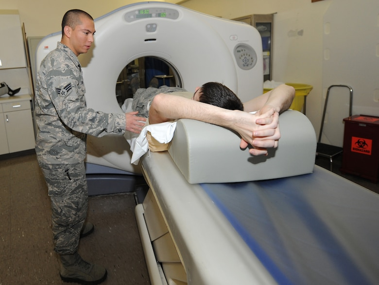 Senior Airman Freddy Toruno, computerized tomography technologist, performs a CT scan Nov. 9 at the David Grant USAF Medical Center. The CT scan creates several high-resolution images that are a cross-section of the scanned portion of the body; together these images provide accurate information about the patient's anatomy and tissue density.  (U.S. Air Force photo/Staff Sgt. Liliana Moreno)