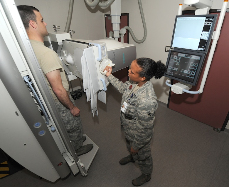 Airman 1st Class Tara Jones, diagnostic imaging technologist, demonstrates fluoroscopy Nov. 9 at the David Grant USAF Medical Center. Fluoroscopy is an imaging technique commonly used by physicians to obtain real-time moving images of the internal structures of a patient through the use of a fluoroscope. (U.S. Air Force photo/Staff Sgt. Liliana Moreno)