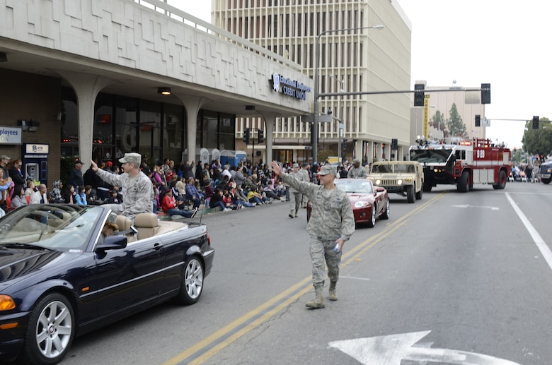 U.S. Air Force Colonel Sami Said, 144th Fighter Wing Commander, California Air National Guard, waves to the spectators as he walks in the 92nd Annual Fresno Veterans Day Parade.  The parade is considered the largest event of its kind west of the Mississippi with over 9,000 participants and volunteers.  (U.S. Air Force photo SMSgt Chris Drudge)