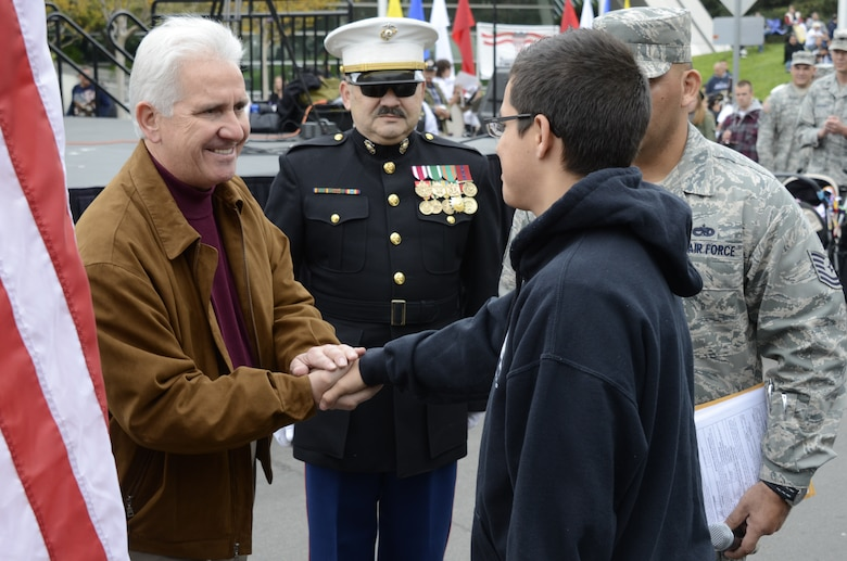 Congressman Jim Costa, 20th District, shakes the hand of the 144th Fighter Wing's newest recruit, Joshua De Leon.  Joshua enlisted into the Calif. Air National Guard on Nov. 11, 2011 prior to the start of the largest Veterans Day Parade west of the Mississippi.  (U.S. Air Force photo by SMSgt. Chris Drudge)