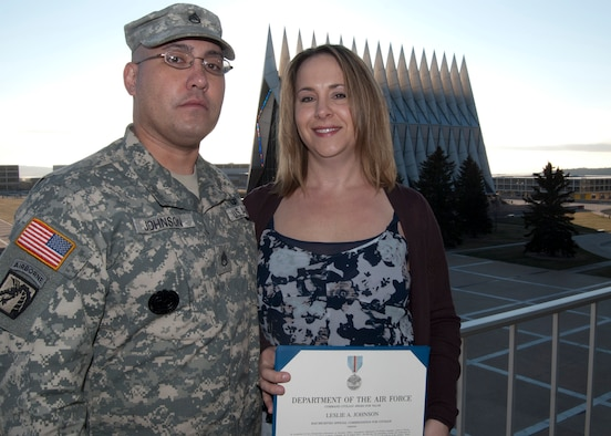 Leslie Johnson, right, poses for a photograph with her husband, Army Staff Sgt. Jeremiah Johnson, near the Air Force Academy's Cadet Chapel Nov. 16, 2011. Johnson received a Command Civilian Award for Valor from Academy Superintendent Lt. Gen. Mike Gould for placing herself in harm's way to rescue a 21-year-old resident of Colorado Springs, Colo., on Aug. 10. (U.S. Air Force photo/Don Branum)