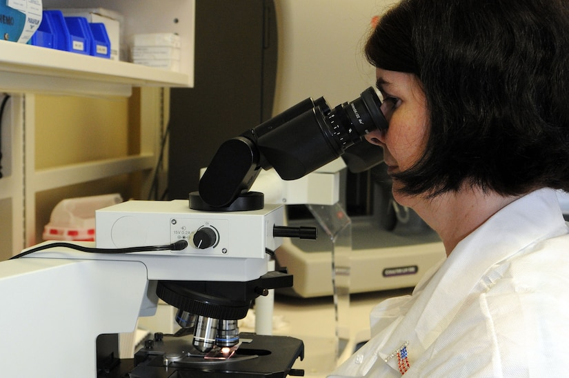 Medical lab technician Lea Shoup views a blood smear through a microscope, counting the number of white blood cells at the hematology lab at Naval Health Clinic Charleston. (U.S. Navy photo/Petty Officer 1st Class Jennifer Hudson)