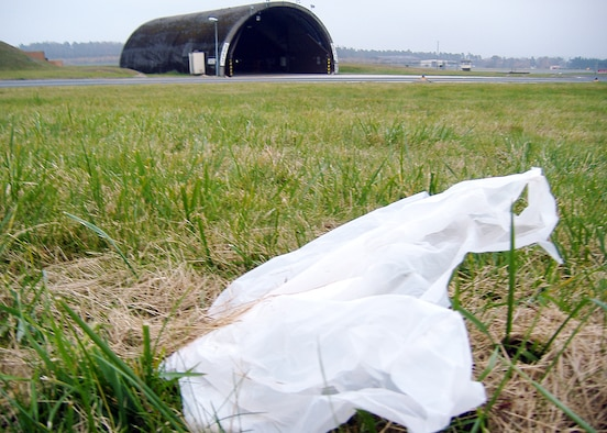 SPANGDAHLEM AIR BASE, Germany – A plastic bag rests in the grass near the flightline here Nov. 8. Foreign object debris like this can damage government equipment. The 52nd Fighter Wing's foreign object damage manager, in collaboration with base civilian agencies, provided re-usable grocery bags to Airmen and their families at the commissary in an effort to enhance recognition of the dangers loose debris have on the base's flying mission. (U.S. Air Force photo/Master Sgt. Matthew LaNew)