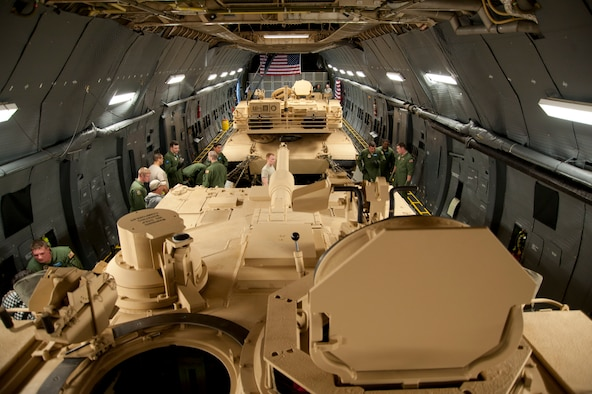 Two M-1 Abrams tanks from Aberdeen Proving Ground are loaded in the cargo area of the C-5M Super Galaxy assigned to Dover Air Force Base, Del. The C-5M currently holds 43 world aviation records in airlift. The modernized version of the C-5, the Super Galaxy has 70 improvements, including new GE CF6 engines providing 22 percent more thrust and cutting climb time in half. New lighting in the cargo area increase safety of loading and offloading cargo. (U.S. Air Force photo/Lt. Col. Chad E. Gibson)