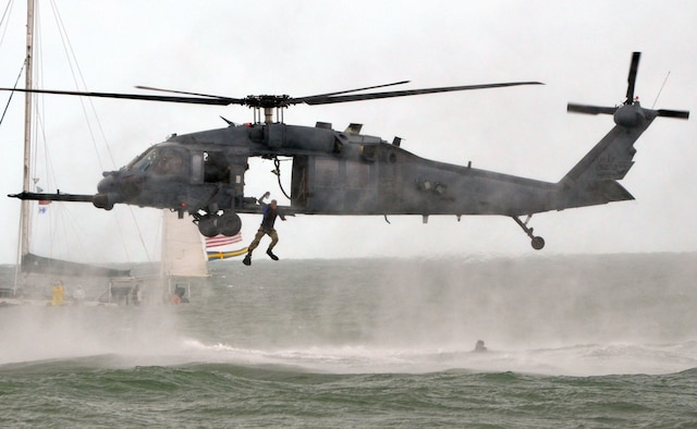 Airmen from the 920th Rescue Wing perform a water rescue demonstration using an HH-60G Pave Hawk Nov. 5, 2011, during the Cocoa Beach Air Show 2011 in Cocoa Beach, Fla. (U.S. Air Force photo/Staff. Sgt. Anna-Marie Wyant).