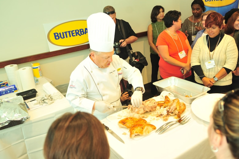 Butterball master chef Tony Seta shows students of Butterball University how to properly carve a turkey at the Butterball Headquarters in Garner, N.C., Nov. 15, 2011. Seta, who has been a chef for more than 30 years, encouraged the students to have fun while cooking and to always maintain proper food storage techniques to have a safe holiday. Seta is one of only 65 certified Master Chef's by the American Culinary Federation and hails from Hyde Park, N.Y. (U.S. Air Force photo by Senior Airman Marissa Tucker)