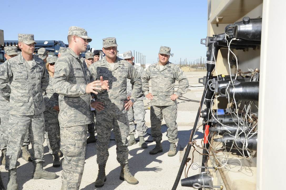 Maj. Gen. Leonard Patrick receives a brief on the Contingency Electrical Power System by Airman Joshua Carpenter during his tour of the 366th Training Squadron Electrical Systems Apprentice Course, Nov. 16, at Sheppard Air Force Base, Texas. Patrick, Second Air Force commander, paid a visit to Sheppard Nov. 14-16 to tour the 82nd Training Wing and speak with Sheppard members. (U.S. Air Force photo/Frank Carter)