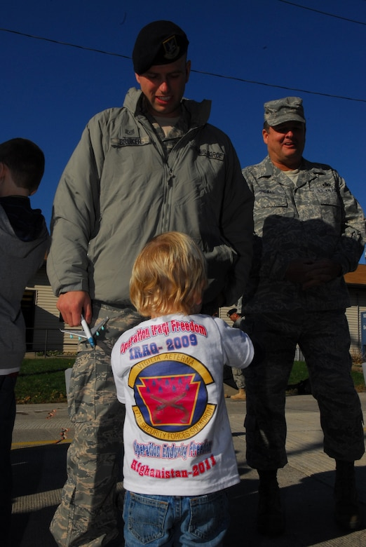 Five members of the 171st Security Forces Squadron serving with POMLT 2, a police operational mentor and liaison team, returned from Afghanistan today. Deployed for nearly a year, they were greeted by family members, friends and fellow Airmen.  (National Guard photo by Tech. Sgt. Stacy Gault)
