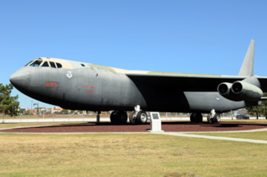 """The B-52D on display in the Tinker Heritage Airpark, serial number 56-695, saw fire and rain in its glory days. This Stratofortress served in both the Iron Bomb raids of Arc Light as well as Linebacker operations in Southeast Asia. The story of these missions, unparalleled for close to 20 years, might as well be called Air Force 101, but the B-52 fleet has always belonged to Tinker Air Force Base.  Long-range heavy bombers have been a part of the nation's """"nuclear triad"""" defense since the 1950s, along with missiles and submarines.  The first such aircraft to meet that need was the B-52. The B-52 set many records in its early years of service. On Jan. 18, 1957, three B-52Bs completed the world's first non-stop round-the-world flight by jet aircraft, lasting 45 hours and 19 minutes with only three aerial refuelings en route. It was also a B-52 that made the first airborne hydrogen bomb drop over Bikini Atoll on May 21, 1956."""