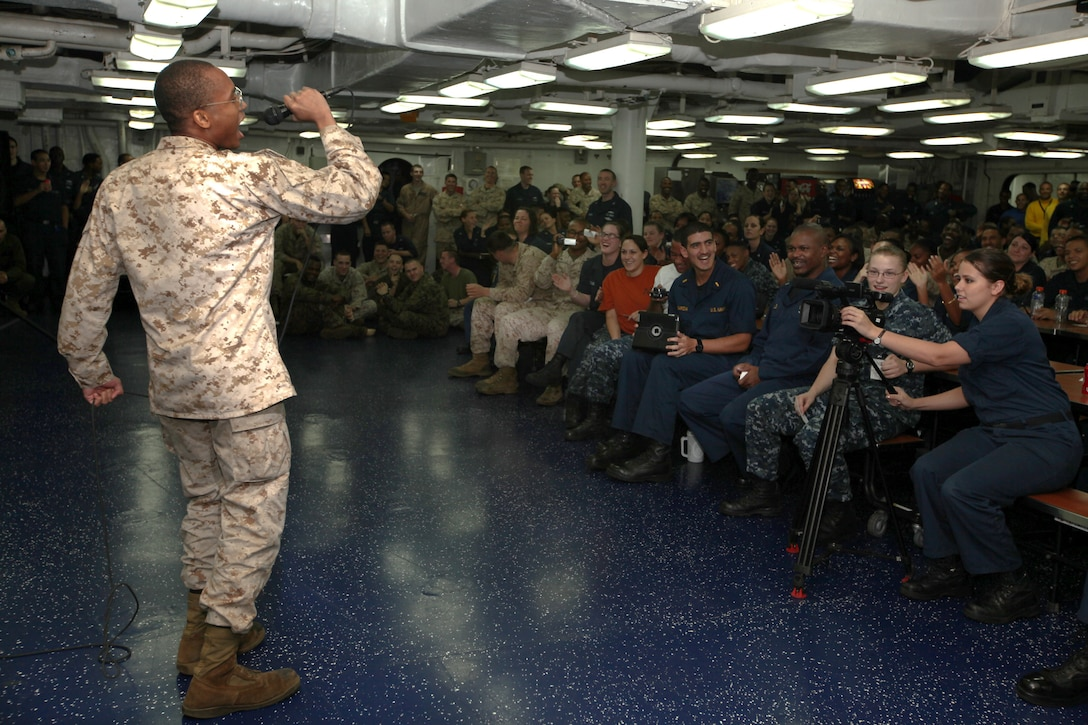 Lance Cpl. Brandon Reason, an aviation technician with Marine Medium Tilt Rotor Squadron (VMM) 263 (Reinforced), 22nd Marine Expeditionary Unit (MEU), and a Wilmington, Del., native, sings in the first round of Bataan Idol aboard multipurpose amphibious assault ship USS Bataan (LHD 5), Nov. 19, 2011.  Appointed judges and the audience will vote off some of the 12 Marines and Sailors with the 22nd MEU and USS Bataan weekly, and crown the first Bataan Idol. The 22nd MEU is currently deployed as part of the Bataan Amphibious Ready Group (BATARG) as the U.S. Central Command theater reserve force, also providing support for maritime security operations and theater security cooperation efforts in the U.S. 5th Fleet area of responsibility.