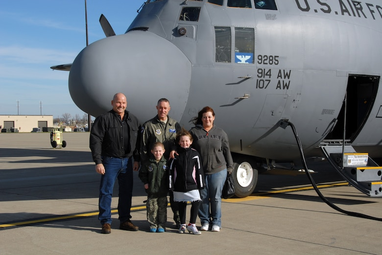 Donovan Benzin became a Guardsman for a day at the 107th Airlift Wing, Niagara Falls ARS. Here he is pictured with his family after touring the inside of the C-130 aircraft.