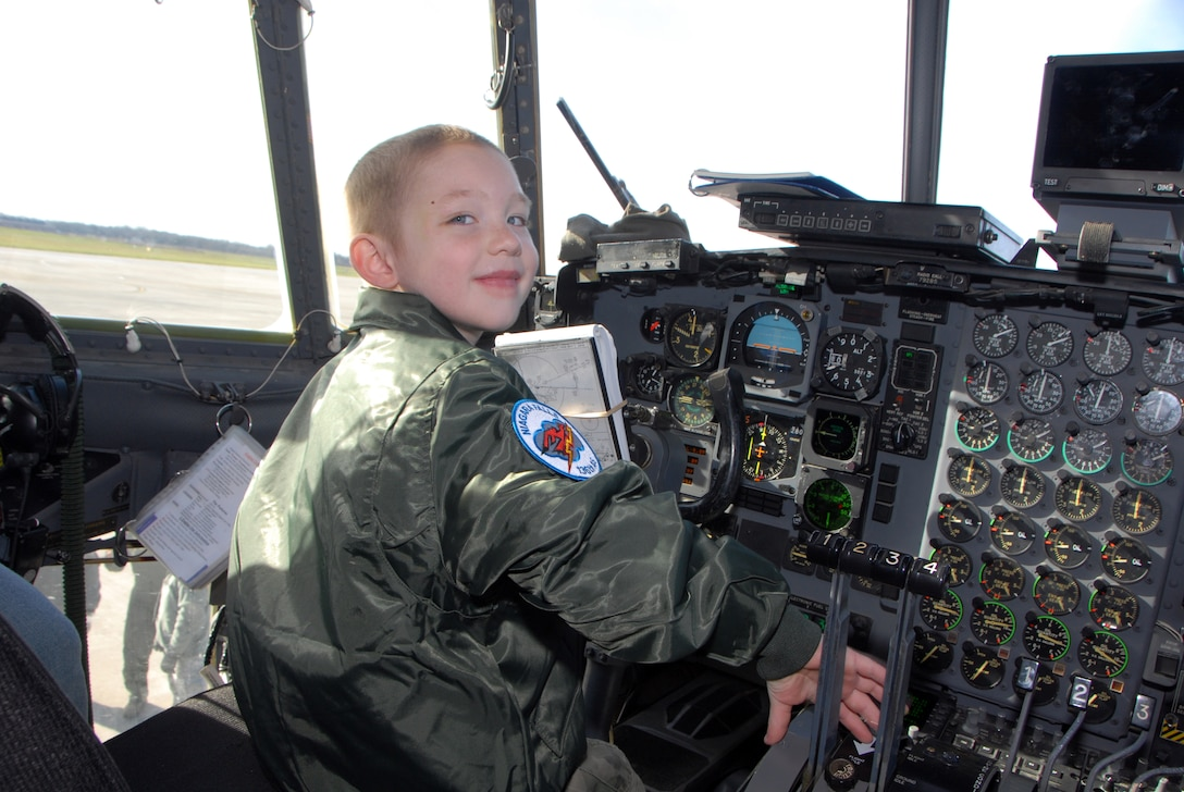 Five-year-old cancer survivor, Donovan Benzin became a Guardsman for a day at the 107th Airlift Wing, Niagara Falls ARS. Here he is exploring the cockpit controls of the C-130 aircraft.