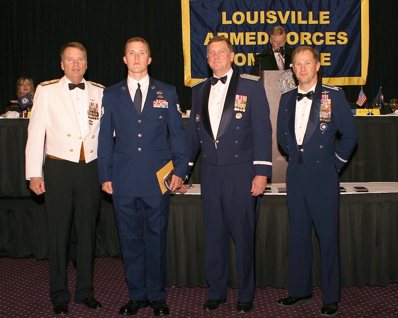 "Staff Sgt. Jeff Kinlaw (second from left), a combat controller in the Kentucky Air National Guard's 123rd Special Tactics Squadron, was honored with the Patriot Award for outstanding military service during the 92nd-annual Louisville Armed Forces Committee Dinner, held May 20, 2011, at the Galt House in Louisville, Ky. Presenting the award are (from left to right) Adm. James A. ""Sandy"" Winnefeld Jr., commander of U.S. Northern Command and the North American Aerospace Defense Command; Maj. Gen. Edward W. Tonini, Kentucky's adjutant general; and Col. Steven Bullard, vice commander of the Kentucky Air National Guard's 123rd Airlift Wing. (Courtesy photo)"