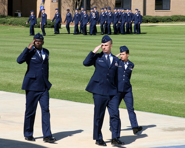 2nd Lt. Nick Reinke (center), a pilot trainee in the Kentucky Air National Guard's 165th Airlift Squadron, salutes the commandant of the Academy of Military Science during a graduation parade March 3, 2011, for newly commissioned Air Force officers at Maxwell Air Force Base, Ala. Lieutenant Reinke was named Distinguished Graduate of his class and was selected by his peers to serve as Officer Candidate Wing Commander. He is slated to begin Undergraduate Pilot Training at Columbus Air Force Base, Miss., this summer. (Courtesy photo)