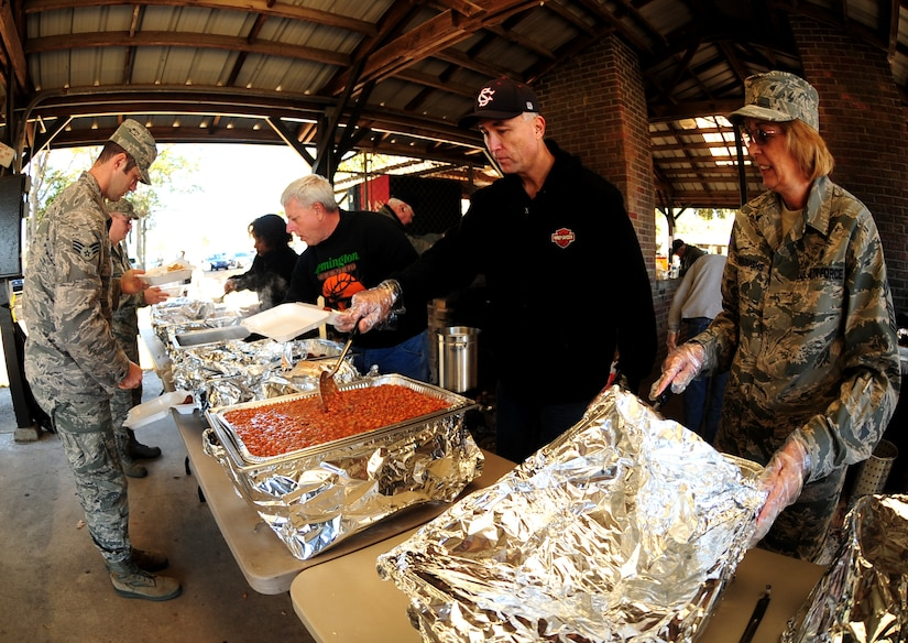 The Joint Base Charleston Chief's group serves Airmen at the picnic grounds Nov. 18. The fish fry is held annually to promote a sense of camaraderie between all units on base. (U.S. Air Force photo/Staff Sgt. Katie Gieratz)