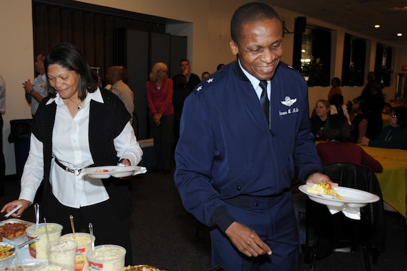 "Maj. Gen. Darren McDew and his wife Evelyn lead Air Force District of Washington teammates down the buffet line during a Thanksgiving feast at the Andrews Community Activity Center Nov. 17. The general and his wife took the time to say ""thank you"" to all those gathered at the holiday event."