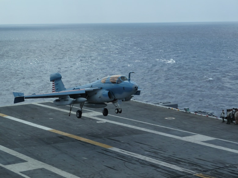 An EA-6B Prowler comes in for a landing aboard the Nimitz-class aircraft carrier USS Dwight D. Eisenhower (CVN 69) July 10, 2011, during carrier qualifications while underway in the Atlantic Ocean. Throughout carrier qualifications pilots are tested on their ability to land in both day and night situations. (Courtesy photo)