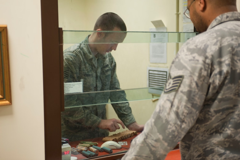 Staff Sgt. Jeremy Knowles, 39th Comptroller Squadron, counts rolls of coins before exchanging them for bills Nov. 4, 2011, at Incirlik Air Base, Turkey. The cash cage on Incirlik is the only one on a U.S. Air Forces in Europe installation and offers base residents a place to cash checks. (U.S. Air Force photo by Senior Airman Clayton Lenhardt/Released)