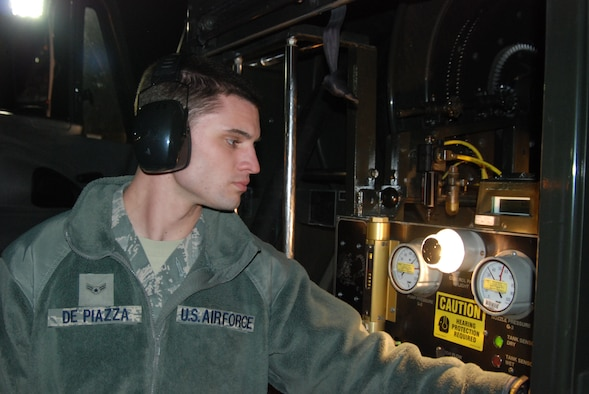 U.S. Air Force Airman 1st Class Dillon DePiazza monitors gauges while fueling an F-15E Strike Eagle on the flightline at Mountain Home Air Force Base, Idaho, Nov. 22, 2011. DePiazza is a recent addition to the petroleum oil and lubricants crew, but in his short time has made a positive impact on the mission. (U.S. Air Force photo by Airman 1st Class Shane M. Phipps/Released)