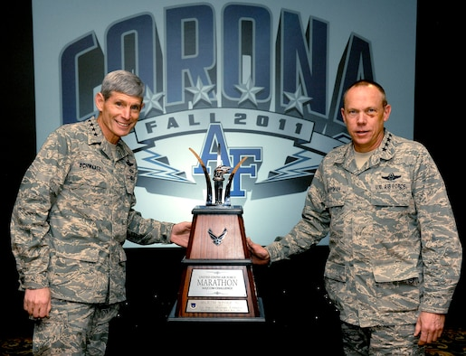 Air Force Chief of Staff Gen. Norton Schwartz awards the Marathon MAJCOM Challenge trophy to Gen. Donald Hoffman, Air Force Materiel Command commander, on Nov. 4, 2011, at the U.S. Air Force Academy, Colo.  This was the second time AFMC has won the coveted trophy.  (U.S. Air Force photo)