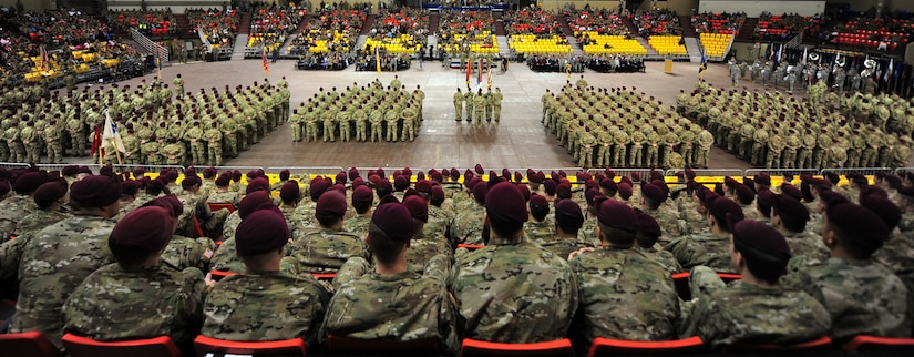 """Soldiers from 4th Brigade Combat Team (Airborne), 25th Infantry Division participate on their deployment ceremony at Sullivan Arena, Anchorage, Alaska, Nov. 29, 2011. The 4-25 ABCT """"Spartan Brigade"""" will deploy 3,500 Soldiers on a series of flights in November and December en route to Afghanistan. (U.S. Air Force photo/Staff Sgt. Sheila deVera)"""