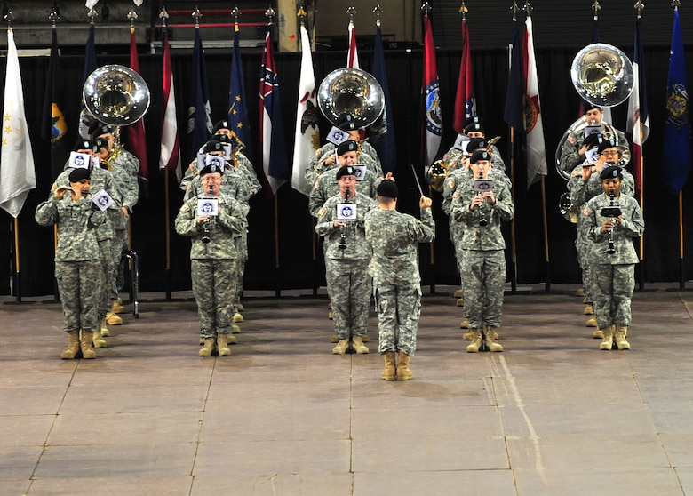 "Soldiers of the 9th Army Band perform during the 4th Brigade Combat Team (Airborne), 25th Infantry Division deployment ceremony at Sullivan Arena, Anchorage, Alaska, Nov. 29, 2011. The 4-25 ABCT ""Spartan Brigade"" will deploy 3,500 Soldiers on a series of flights in November and December en route to Afghanistan. The 9th Army Band is assigned to Fort Wainwright, Alaska. (U.S. Air Force photo/Staff Sgt. Sheila deVera)"