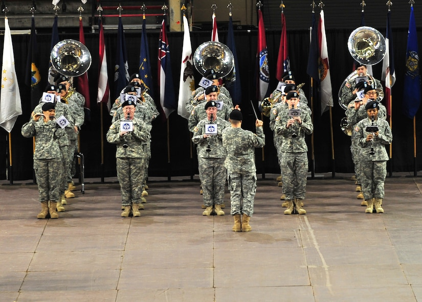 """Soldiers of the 9th Army Band perform during the 4th Brigade Combat Team (Airborne), 25th Infantry Division deployment ceremony at Sullivan Arena, Anchorage, Alaska, Nov. 29, 2011. The 4-25 ABCT """"Spartan Brigade"""" will deploy 3,500 Soldiers on a series of flights in November and December en route to Afghanistan. The 9th Army Band is assigned to Fort Wainwright, Alaska. (U.S. Air Force photo/Staff Sgt. Sheila deVera)"""