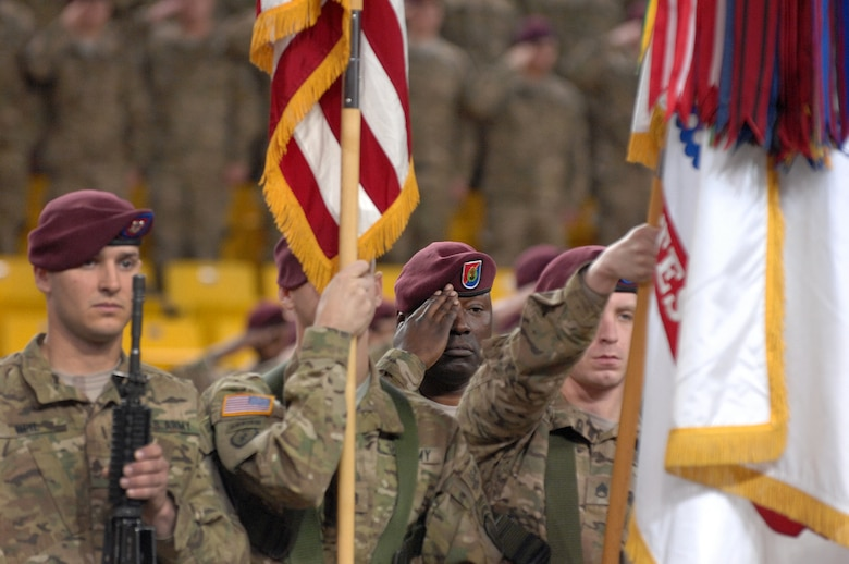 "Command Sgt. Maj. Terry Gardner, 4th Brigade Combat Team (Airborne), 25th Infantry Division, salutes during the playing of the national anthem during the 4-25th ABCT's deployment ceremony at Sullivan Arena, Anchorage, Alaska, Nov. 29, 2011.  The 4-25th ABCT, ""Spartan Brigade,"" will deploy 3,500 Soldiers on a series of flights in November and December en route to Afghanistan. (U.S. Air Force photo/Staff Sgt. Zachary Wolf)"