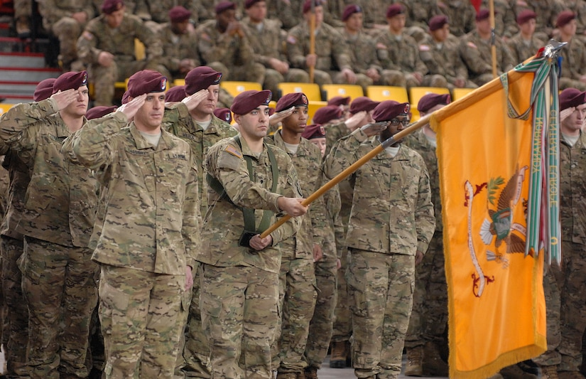 """Soldiers of the 1st Squadron (Airborne), 40th Cavalry Regiment, salute during the national anthem at the 4th Brigade Combat Team (Airborne), 25th Infantry Division's deployment ceremony at Sullivan Arena, Anchorage, Alaska, Nov. 29, 2011.  The 4-25th ABCT, """"Spartan Brigade,"""" will deploy 3,500 Soldiers on a series of flights in November and December en route to Afghanistan. (U.S. Air Force photo/Staff Sgt. Zachary Wolf)"""