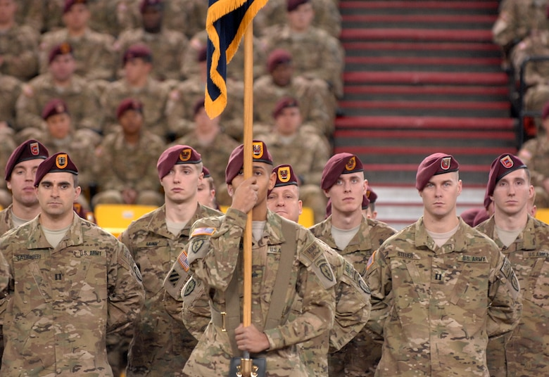 "Soldiers of the 4th Brigade Combat Team (Airborne), 25th Infantry Division stand at parade rest during the deployment ceremony at Sullivan Arena, Anchorage, Alaska, Nov. 29, 2011.  The 4-25th ABCT, ""Spartan Brigade,"" will deploy 3,500 Soldiers on a series of flights in November and December en route to Afghanistan. (U.S. Air Force photo/Staff Sgt. Zachary Wolf)"