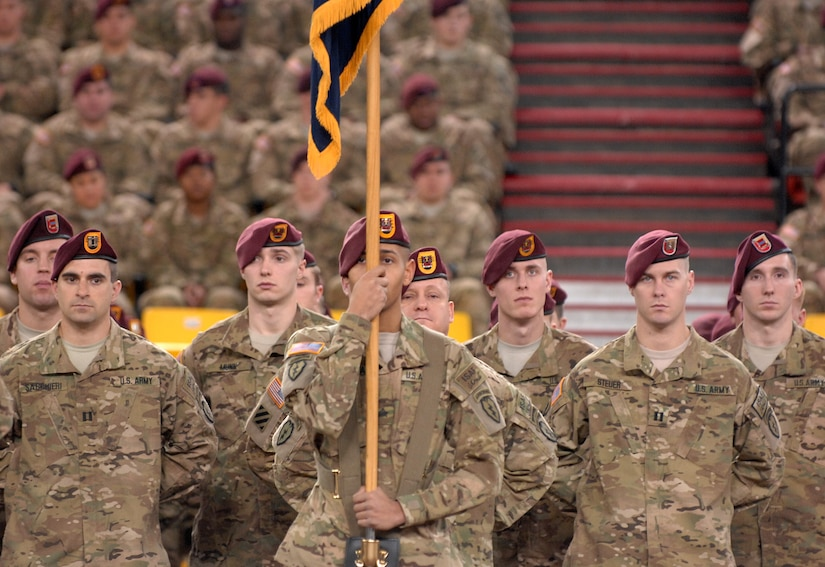 """Soldiers of the 4th Brigade Combat Team (Airborne), 25th Infantry Division stand at parade rest during the deployment ceremony at Sullivan Arena, Anchorage, Alaska, Nov. 29, 2011.  The 4-25th ABCT, """"Spartan Brigade,"""" will deploy 3,500 Soldiers on a series of flights in November and December en route to Afghanistan. (U.S. Air Force photo/Staff Sgt. Zachary Wolf)"""