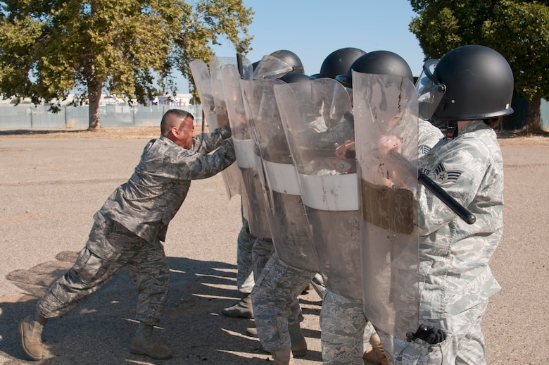 Members of the 144th Security Forces Squadron take part in specialized riot contol training. The special tactics are instructed by Staff Sgt. Raul Amezcua and focus on crowd dispersement, force integrity and protection of assets. (U.S. Air Force photo by Master Sgt. David Loeffler)
