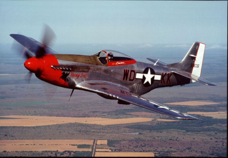 Retired Colorado Air National Guard Col. Michael W. Bertz pilots his P-51 Mustang, 'Stang Evil, circa May 2000. He was inducted into the Colorado Aviation Hall of Fame Oct. 2, 2011, at Wings Over the Rockies Air & Space Museum in Denver. (Photo provided by retired Col. Michael W. Bertz/Used with permission)