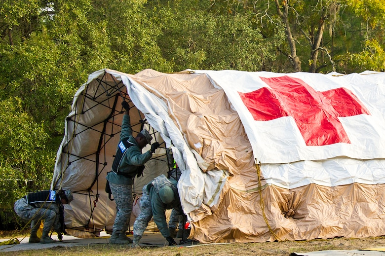 Air National Guard medical personnel from the 116th Medical Group (MDG), Robins Air Force Base, Ga., and the 165th MDG, Savannah, Ga.,  set up a tent used for cold zone triage during Operation Sunrise Rescue at Camp Blanding Joint Training Center, Fla., Nov. 18, 2011.  The combined medical group received a perfect score in the joint force exercise to test their skills as a Chemical, Biological, Radiological, Nuclear, and High Yield Explosive Enhanced Response Force Package.  (National Guard photo by Master Sgt. Roger Parsons/Released)