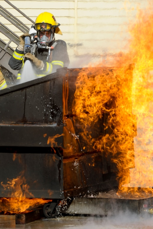 VANDENBERG AIR FORCE BASE, Calif. – A student firefighter from Allen Hancock College Fire Academy puts out a dumpster fire during training at the Turner Bell Fire Training Campus here Wednesday, Nov. 30, 2011. . Allen Hancock College students trained at Vandenberg to help build the required skills while their Public Safety Complex, which will incorporate skill training facilities, is under construction. (U.S. Air Force photo/Staff Sgt. Levi Riendeau)