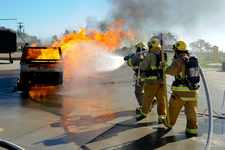 VANDENBERG AIR FORCE BASE, Calif. – A car fire gets extinguished by student firefighters from Allen Hancock College Fire Academy during training at the Turner Bell Fire Training Campus here Wednesday, Nov. 30, 2011. . Allen Hancock College students trained at Vandenberg to help build the required skills while their Public Safety Complex, which will incorporate skill training facilities, is under construction. (U.S. Air Force photo/Staff Sgt. Levi Riendeau)